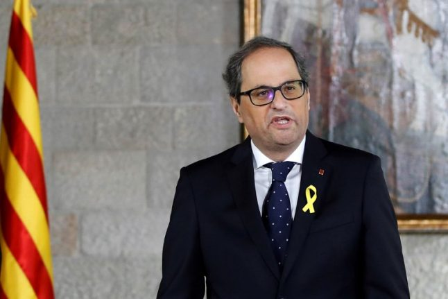 New Catalan leader shuns King and constitution at swearing-in ceremony