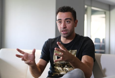 Spanish great Xavi to play on until at least end of year