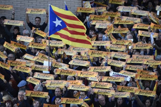 Spain lifts financial controls on Catalonia, rules out referendum