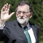 Spain's ousted PM Rajoy bids emotional farewell to PP party