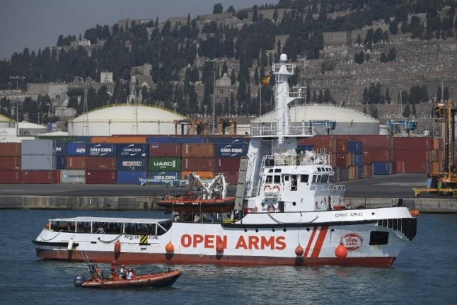 Open Arms ship with 60 migrants aboard docks in Barcelona