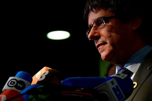 Spain court orders Puigdemont suspended as lawmaker