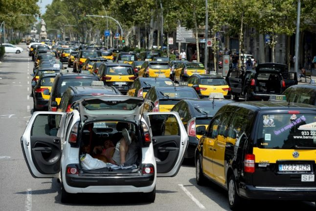 IN PICS: Spain's taxi strike stretches into eighth day