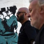 Mural of Spanish police officers snogging 'not a Banksy' after all