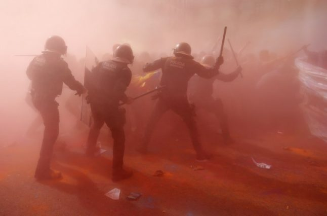 Police clash with Catalan separatists at Spanish rally