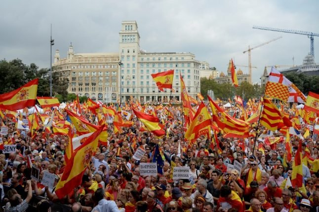 Catalans march for unity on Spain's national day