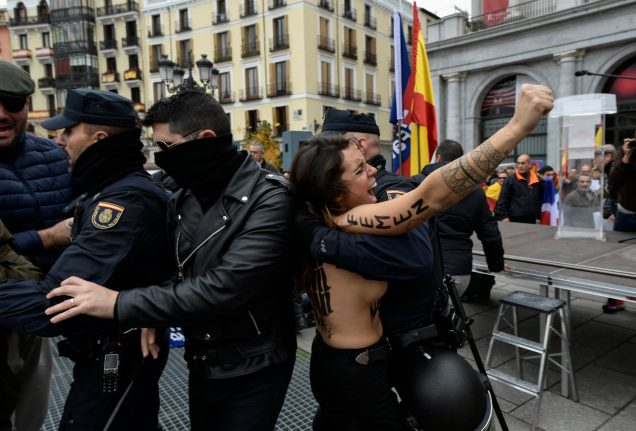 Topless Femen activists disrupt rally of Franco fans in Madrid