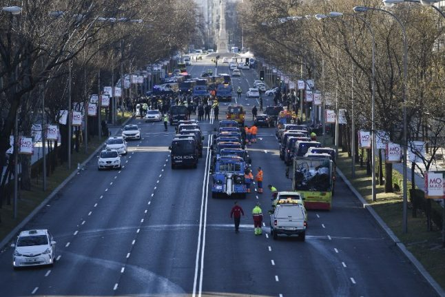 IN PICS: Riot police sent in to clear taxi strike in Madrid