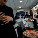 Women enter the select male world of Spanish ham cutters