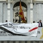 Spain files lawsuit against Catalan president over pro-independence symbols