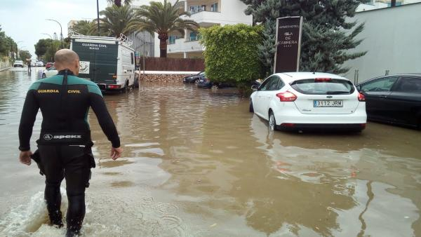 WATCH: Woman escapes car in flashflood as Mallorca and Ibiza hit by violent storms
