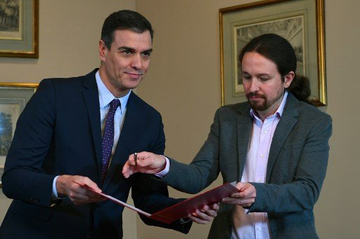 Spain's Socialists and Podemos make pact to form new government
