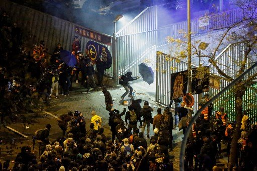 IN PICS: Dozens injured in clashes outside Barcelona's Camp Nou during El Clasico