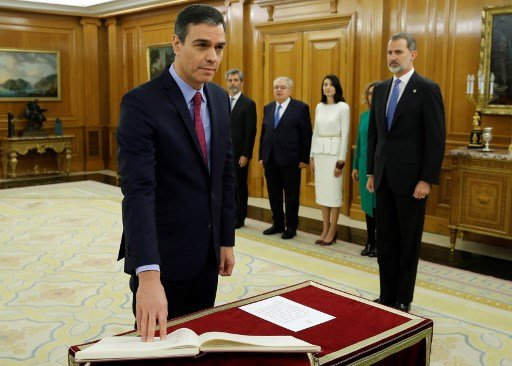 Pedro Sanchez sworn in as head of Spain's first coalition government since 1936