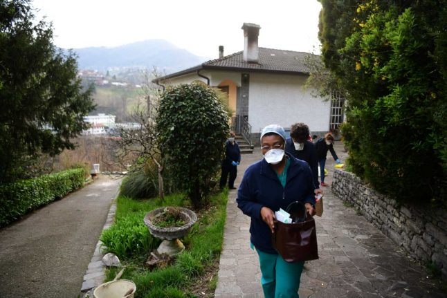 Italy and Spain suffer record deaths as coronavirus infection rate surges