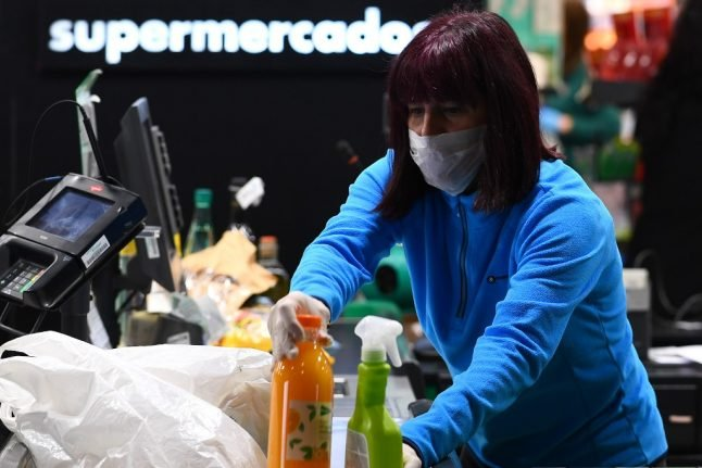 Which jobs are considered essential under Spain's lockdown restrictions?