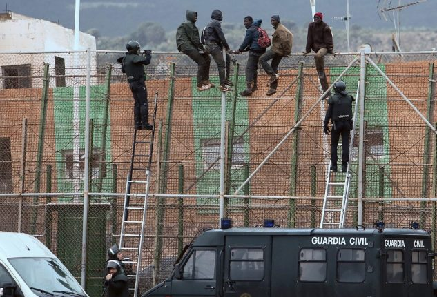 Dozens scale border fence into Spain's North African enclave Melilla