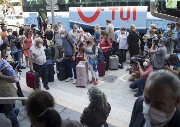 'So glad to be here': Planeload of Germans become first tourists to arrive in Spain under post-lockdown pilot test