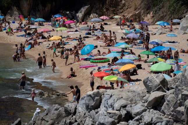 Dozens of Spanish beaches close over virus fears as crowds of sunbathers gather