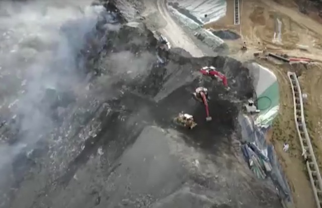 Spanish police arrest owners of rubbish dump where two workers were buried alive by landslide