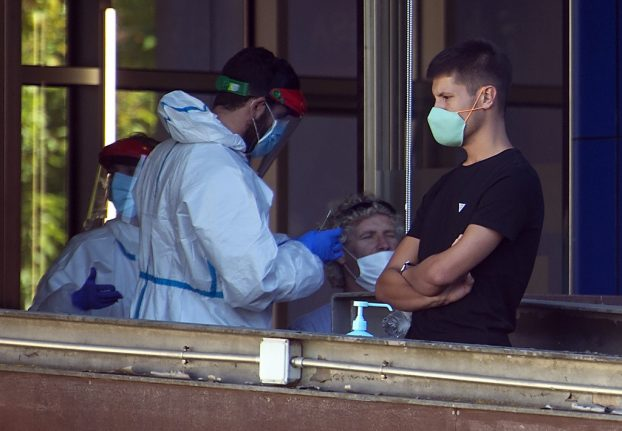 LATEST: Spain reports 23,000 new virus cases over the weekend