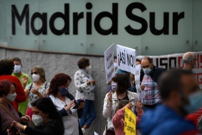 IN PICS: Residents in Madrid's poorest neighbourhoods protest new lockdown 'segregation'