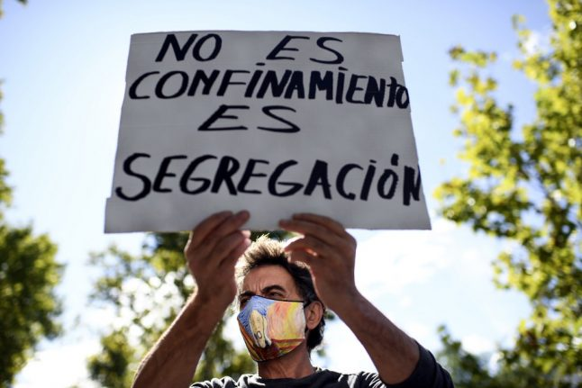 'They don't confine the rich': Hundreds protest partial lockdown in Madrid's low-income barrios