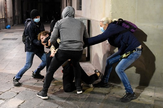 Looting and vandalism during second night of protests in Spain over Covid restrictions