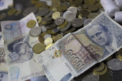 Spaniards urged to dig out their old pesetas and trade them in for euros