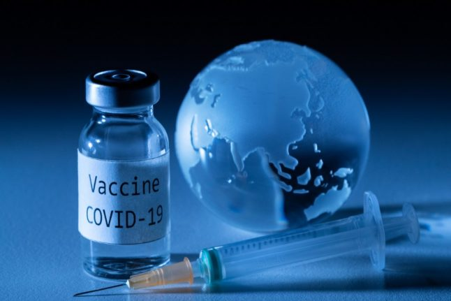 Spain announces plans to vaccinate much of the nation by mid-2021