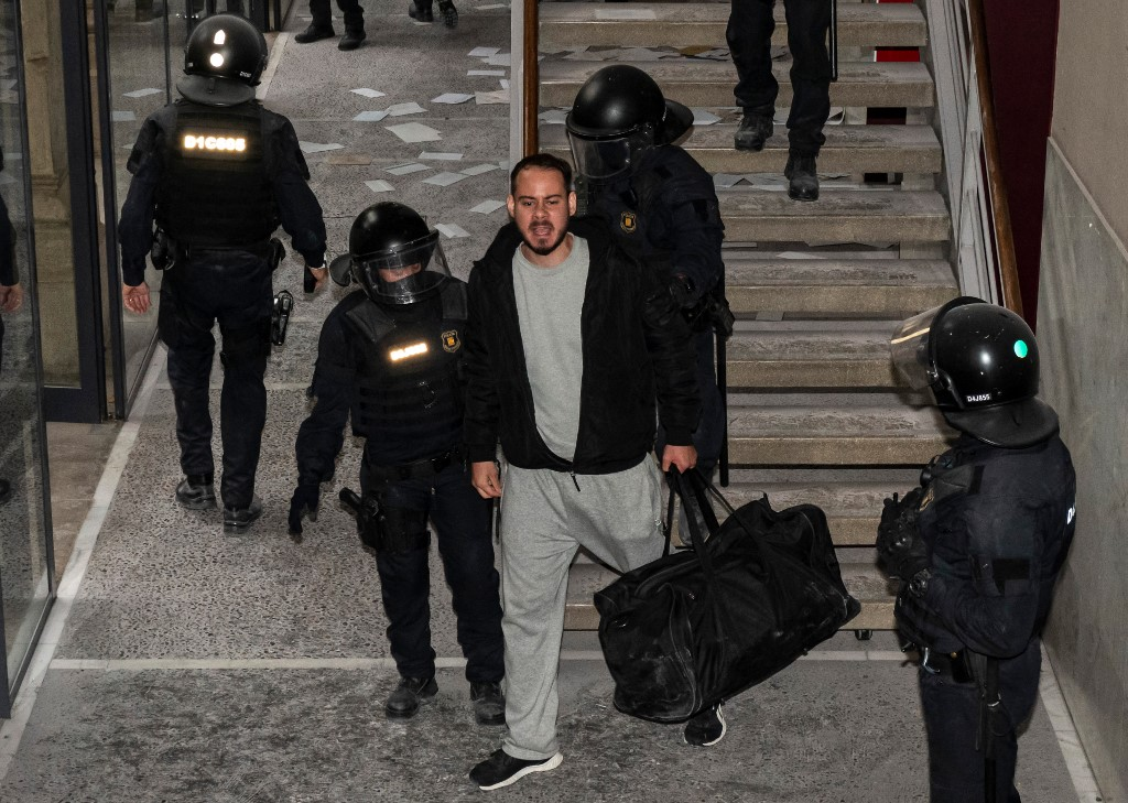 Police arrest rapper holed up in Catalan university to avoid jail for tweets