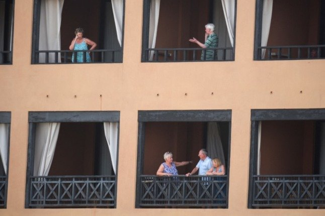 What happens when tourists get Covid-19 while on holiday in Spain?