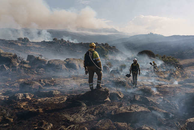Firefighters gain on Spanish blaze as heatwave eases