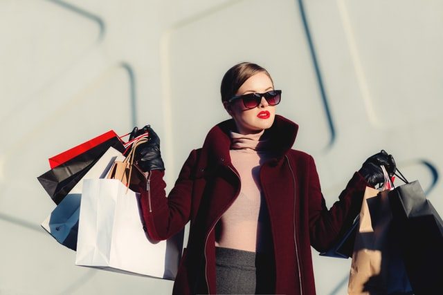 Woman with shopping bags uses tax-free shopping in Spain